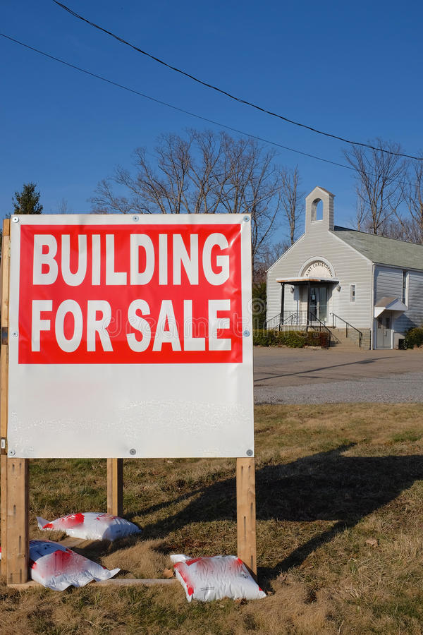 Church for Sale. A church building for sale, part of a consolidation trend for the Catholic Church in the USA. Also. reflects declining church membership and royalty free stock images