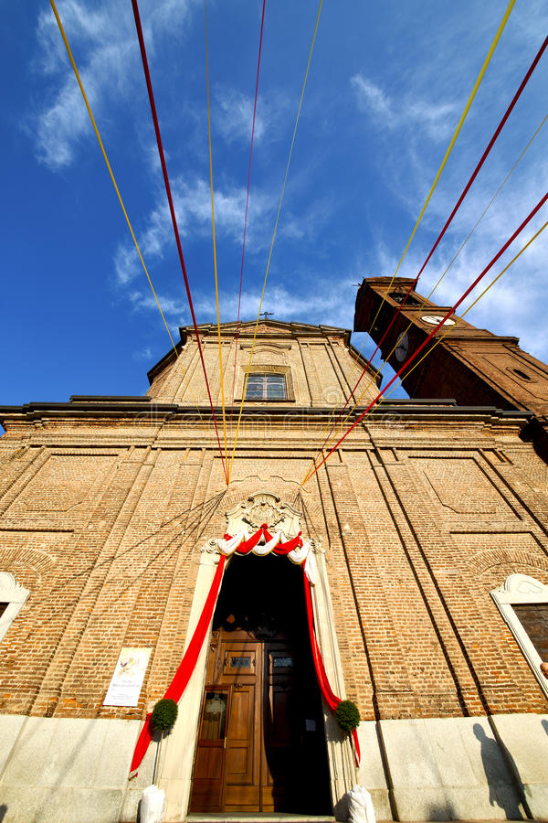 Church in the samarate old closed brick tower italy lo. Church in the samarate closed brick tower sidewalk italy lombardy old royalty free stock photo