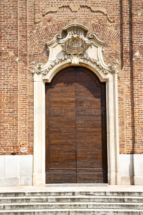 Church samarate varese italy the entrance and mosaic. Church samarate varese italy the old door entrance and mosaic stock image