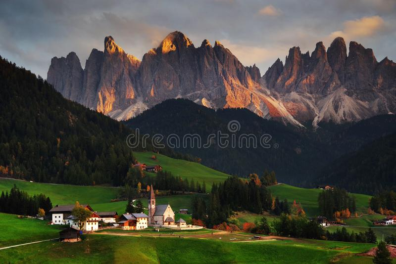 The church Santa Maddalena with the impressive Odle Mountains Group in the background, at sunset. stock photo