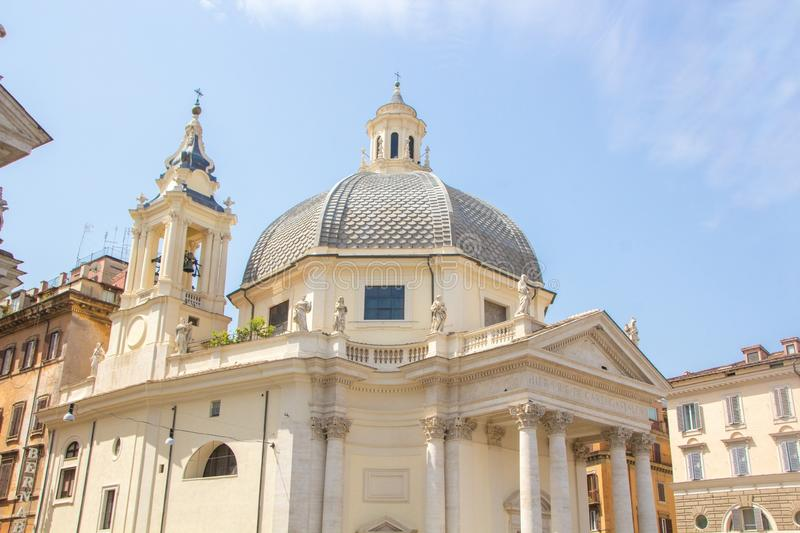 Rome, Italy - May 30, 2018: church Santa Maria dei Miracoli - one of the twin churches on Piazza del Popolo People`s Square royalty free stock photos