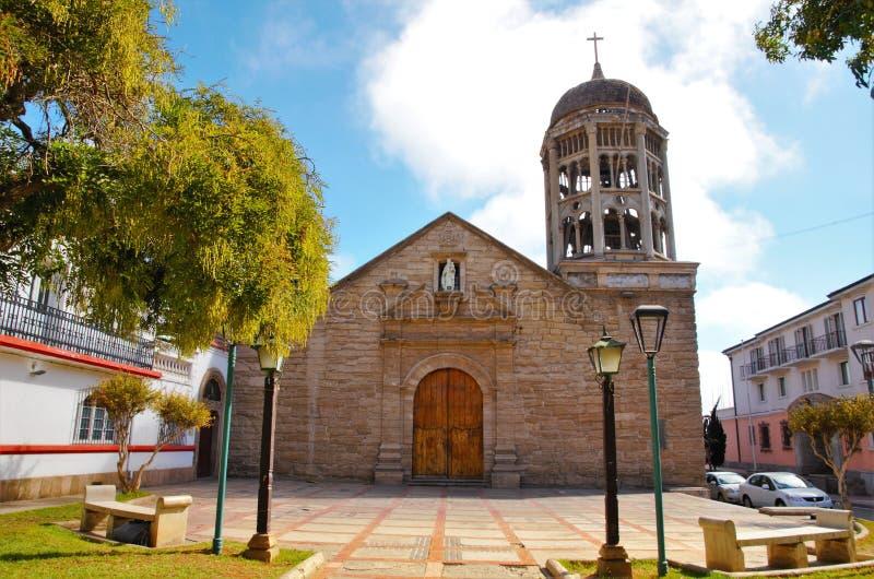 Church Santo Domingo in La Serena, Chile. Low angle view of the stone church Santo Domingo with a blue sky with some clouds in La Serena, Chile, South America royalty free stock photography
