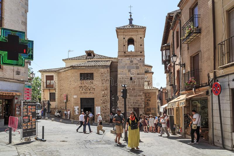 Church of Santo Tome, Toledo, Spain. TOLEDO, SPAIN - MAY 25, 2017: This is the Plaza del Salvador on which comes the bell tower and apse of the church of Santo royalty free stock image