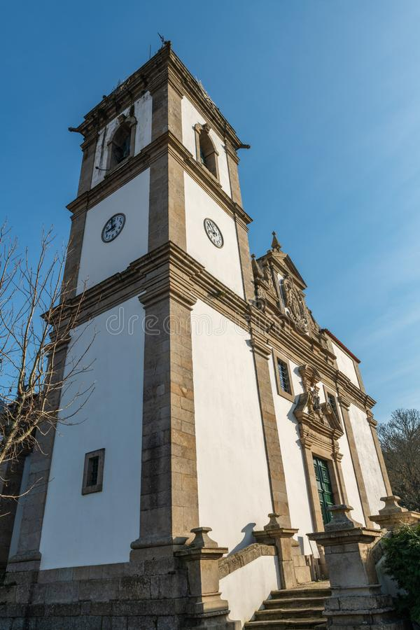 Church of Sao Joao Baptista. The facade of the parish church of Sao Joao Baptista combines the Mannerist and Baroque styles and a prominence of the Baptism of royalty free stock photography