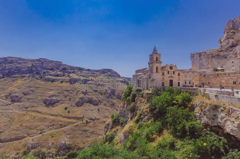 Church in the sassi of Matera, Italy and the valley and creek of. View of the church of the sassi of Matera, Italy next to the valley and creek of the Murgia stock photos
