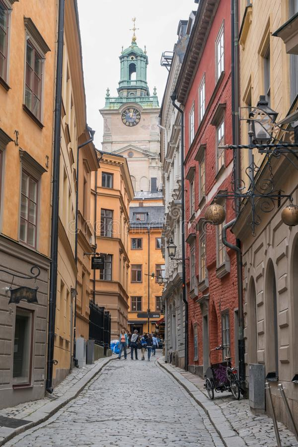 Historic church and colorful street in gamla stan Stockholm stock images
