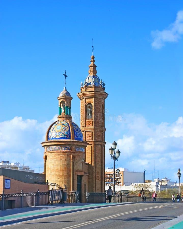 The church. SEVILLE, SPAIN - MAY 3, 2012: The Moorish Revival Chapel of El Carmen next to the Triana bridge, on May 3 in Seville stock photography