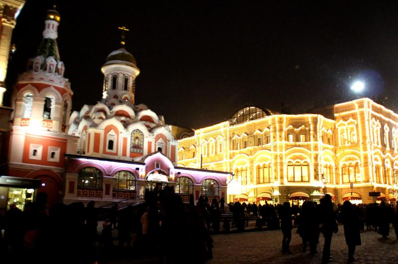 Church and shop GUM decorated with a Christmas installation. Walk around Moscow in the days of the celebration of Christmas and New Year. Views of Moscow from royalty free stock images