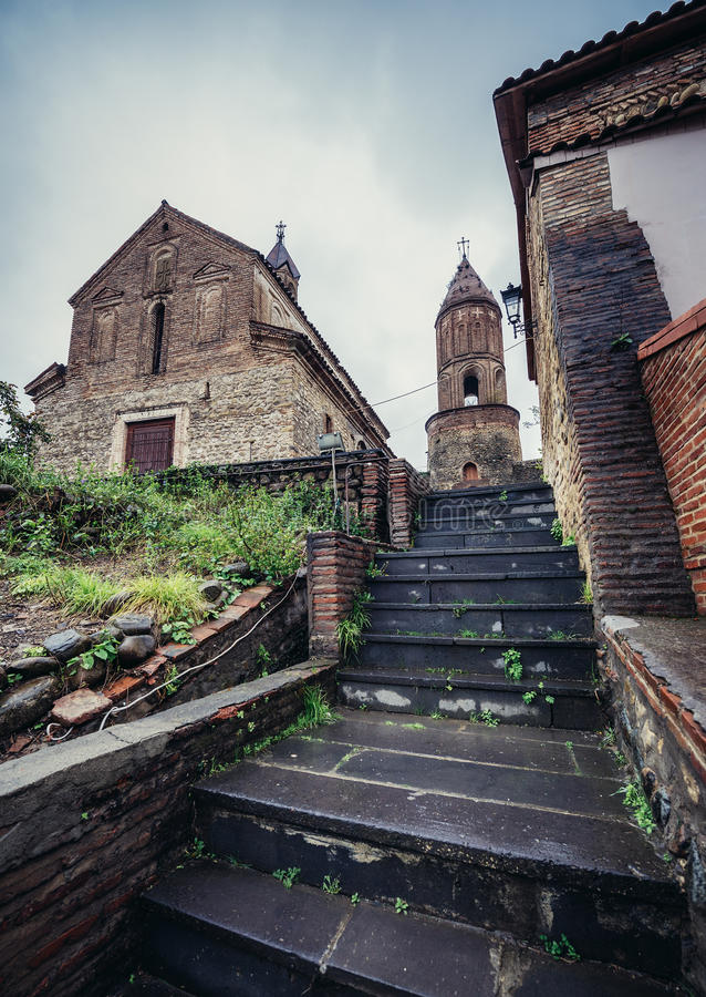 Church in Sighnaghi. Sighnaghi, Georgia - April 24, 2015. St. George's Church and bell tower in Sighnaghi, small town in Kakheti district stock image