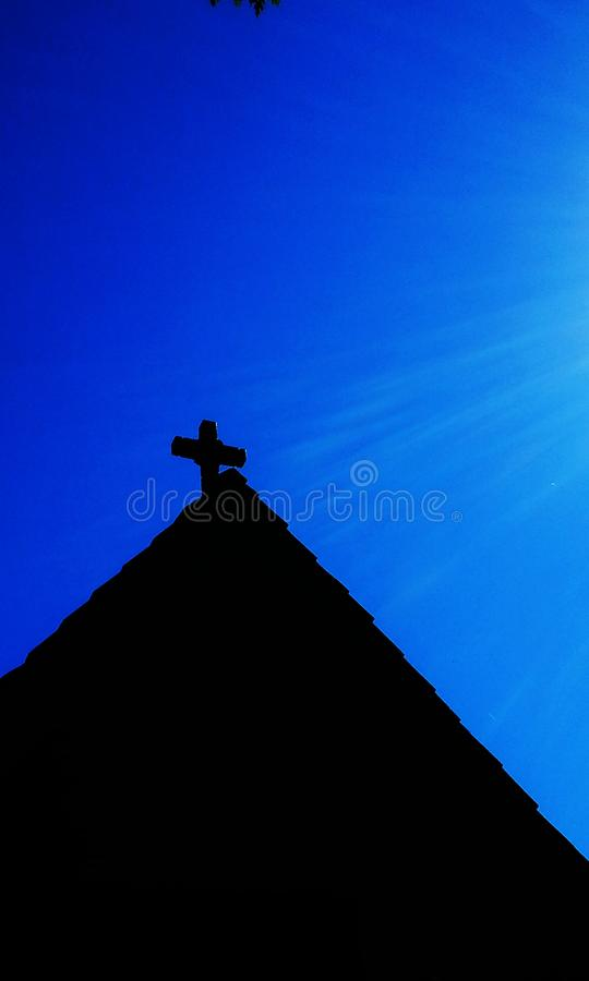 Church in silhouette. The profile of 105 year old St. Oswalds church in Surrey, BC, Canada stock images