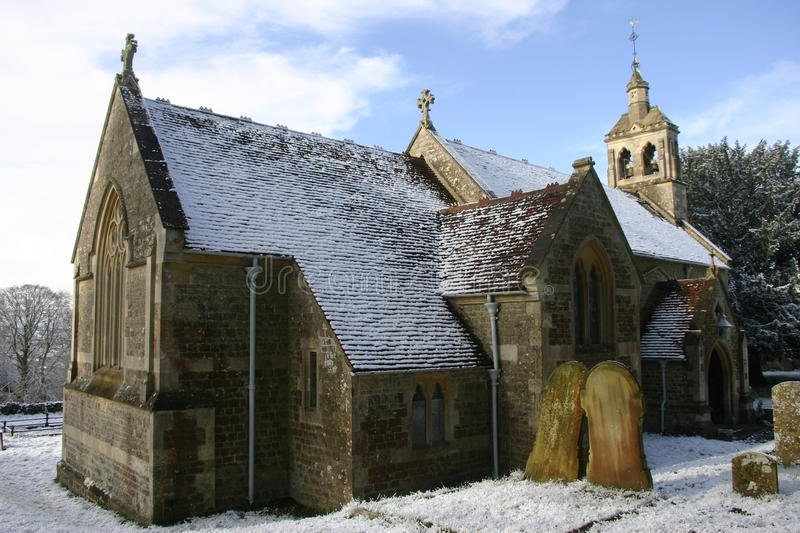 Church in snow. Church surrounded by snow in a winter scene royalty free stock image