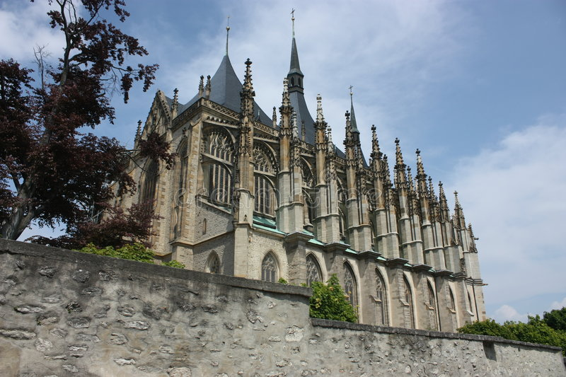 Church of St. Barbara in Kutna Hora. With a wall in the forefront, Czech Republic royalty free stock photography