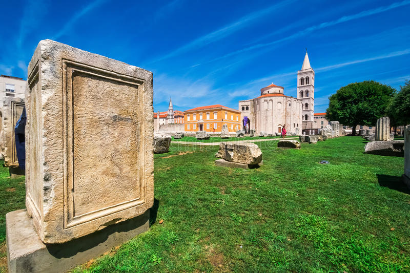 Church of st. Donat, a monumental building from the 9th century with historic roman artefacts in foreground in Zadar, Croatia stock photo