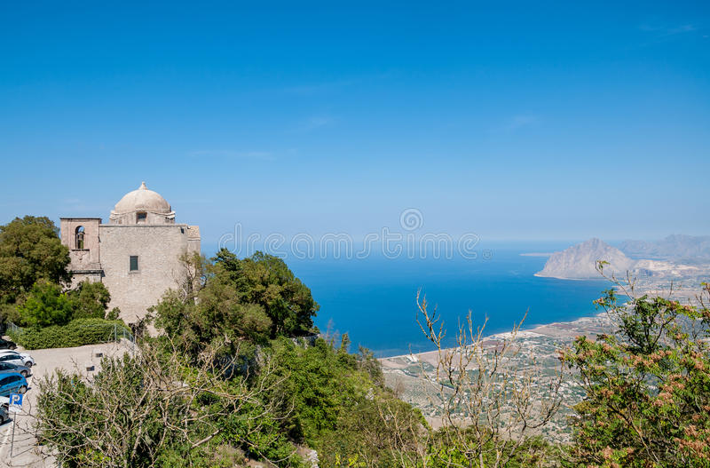 The Church of St. John the Baptist and Cofano mount in Erice. ERICE, ITALY - SEPTEMBER 12, 2015: The Church of St. John the Baptist and Cofano mount in Erice royalty free stock image