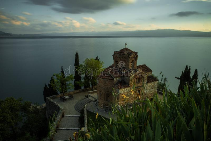 Church of St. John at Kaneo. Saint John at Kaneo is a Macedonian Orthodox church situated on the cliff over Kaneo Beach overlooking Lake Ohrid in the city of royalty free stock photo