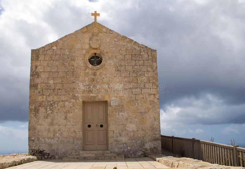 Church of St Mary Magdalen, Malta. St. Mary Magdalene Chapel was rebuilt on the cliff edge in the seventeenth century. Located in Dingli at the mediterranean royalty free stock photography