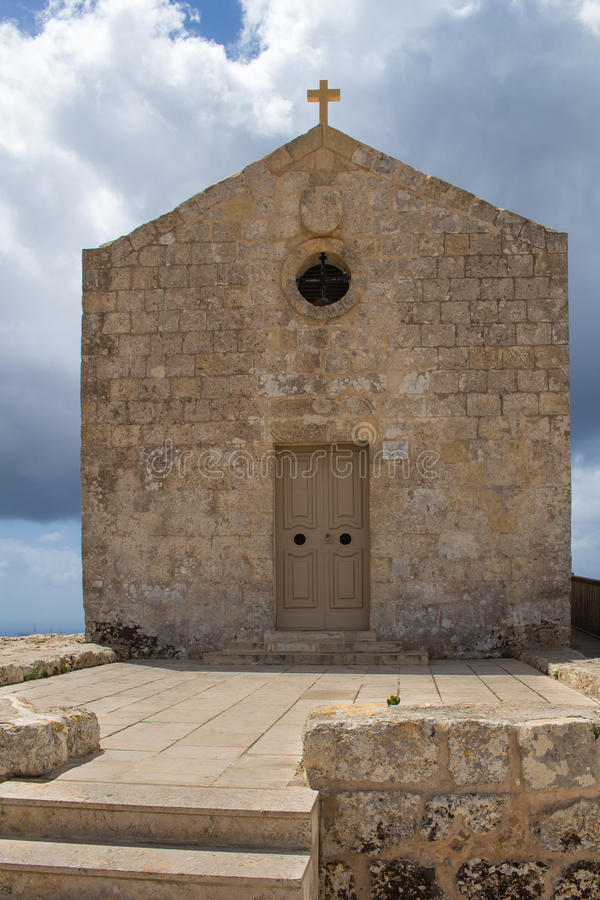 Church of St Mary Magdalen, Malta. St. Mary Magdalene Chapel was rebuilt on the cliff edge in the seventeenth century. Located in Dingli at the mediterranean royalty free stock photo