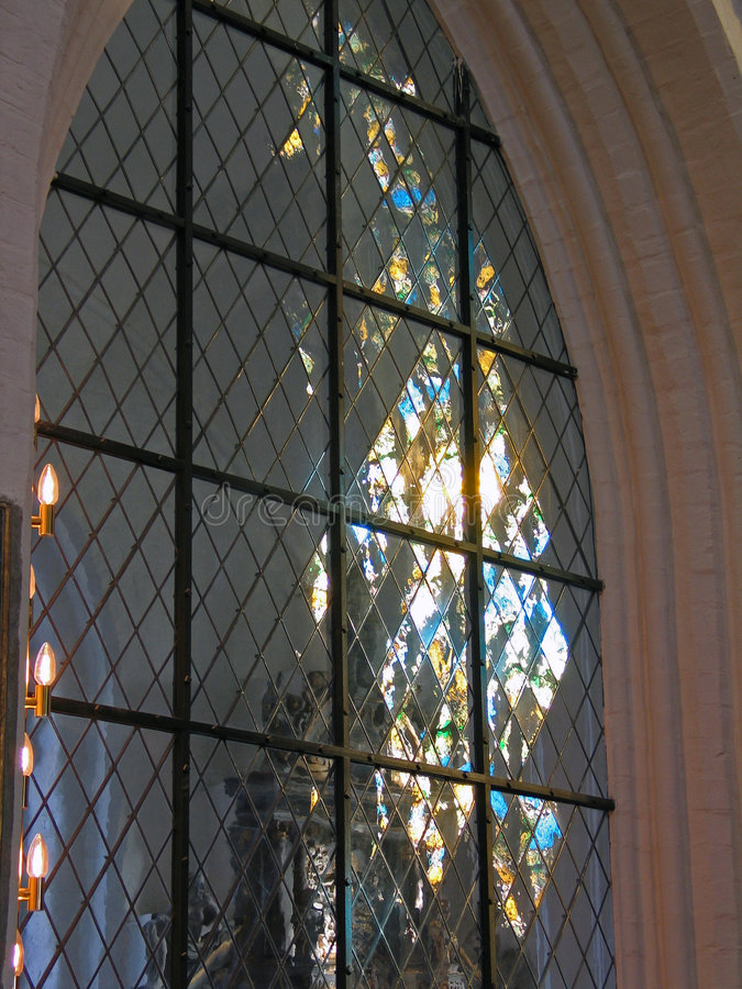 Church Stained Glass Window. With Light Reflection royalty free stock images