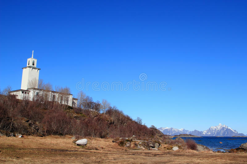 Church of Stamsund and mount on the background. Church of the small village of Stamsund in Lofoten With Vaagakallen Mount on the background royalty free stock photography