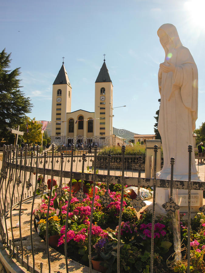 Church and statue of Madonna of Medjugorje royalty free stock images