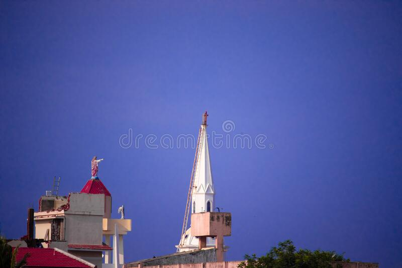 Church steeple against blue skies in chennai. Church steeple against blue skies at chennai in India royalty free stock image