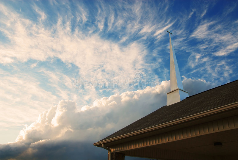 Church Steeple against a cloudy sky royalty free stock photo