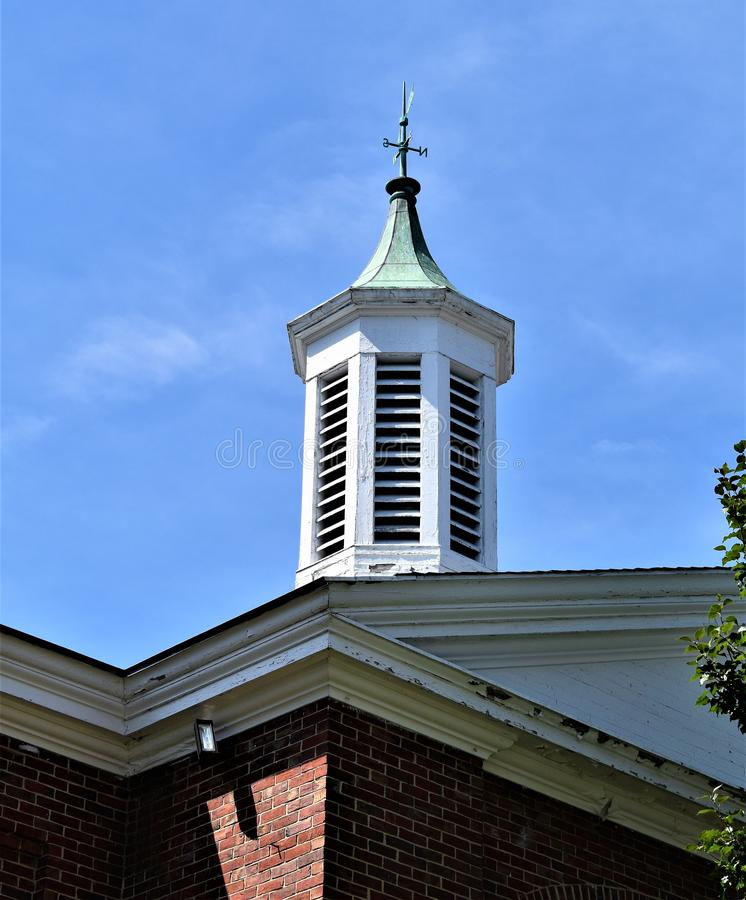 Red Brick Church with white steeple and blue sky, Town of Concord, Middlesex County, Massachusetts, United States. Architecture. Red brick church with white royalty free stock images