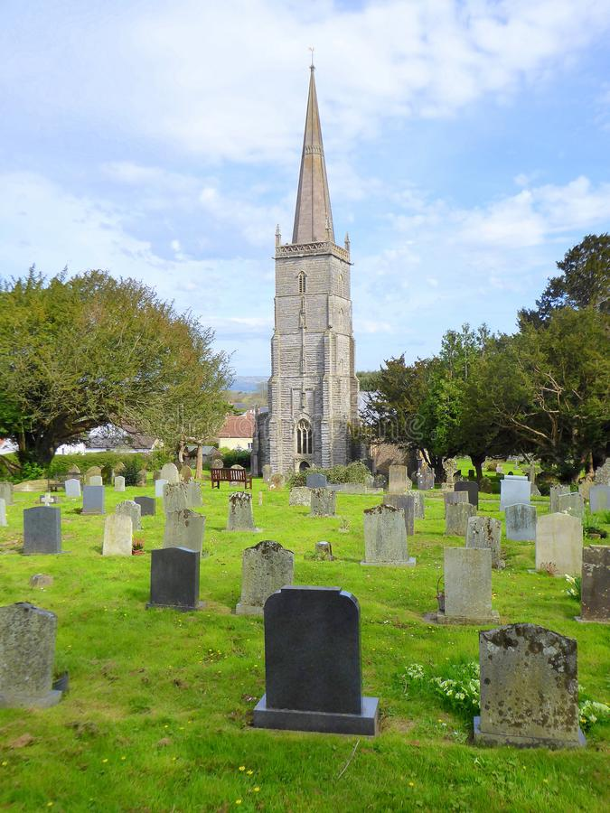 Church with steeple and churchyard. The church of Saint Mary the Virgin and gravestones in the village of East Brent in Somerset, England royalty free stock photo