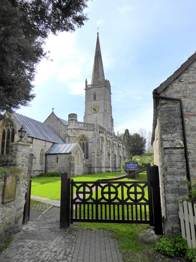 Church with steeple and churchyard. The church of Saint Mary the Virgin and churchyard in the village of East Brent in Somerset, England stock image