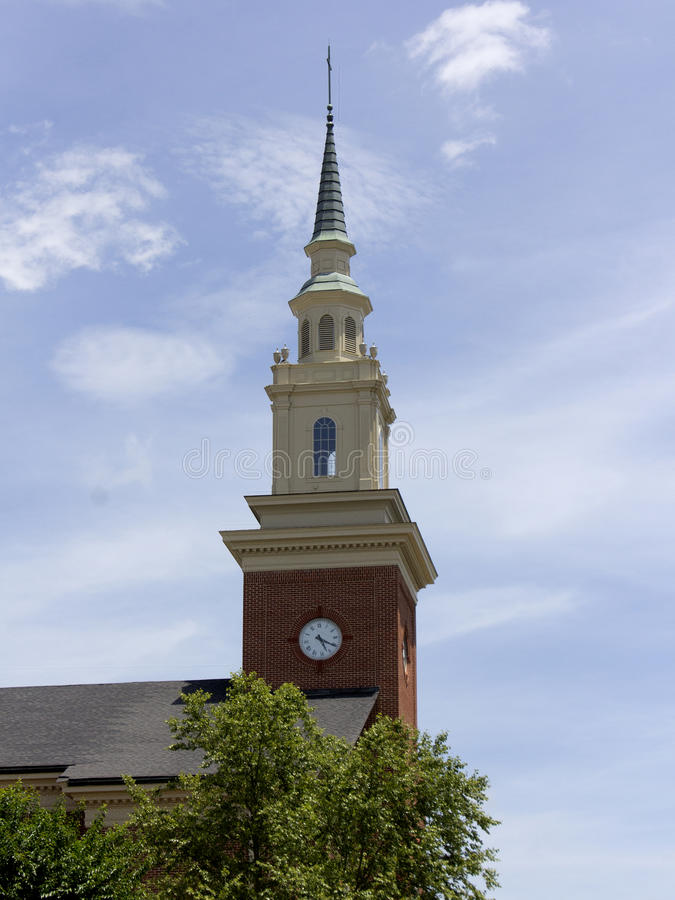 Church steeple with clock royalty free stock photography