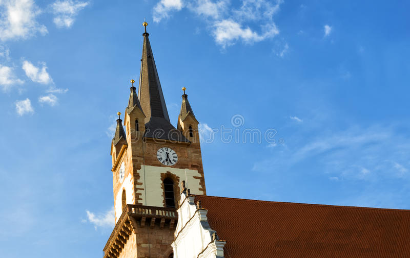 Church steeple of the evangelical church. In Bistrita, Romania royalty free stock image