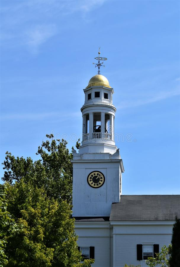 One of many church steeples in Town of Concord, Middlesex County, Massachusetts, United States. Architecture. Church steeple with gold dome, weathervane, bell royalty free stock image