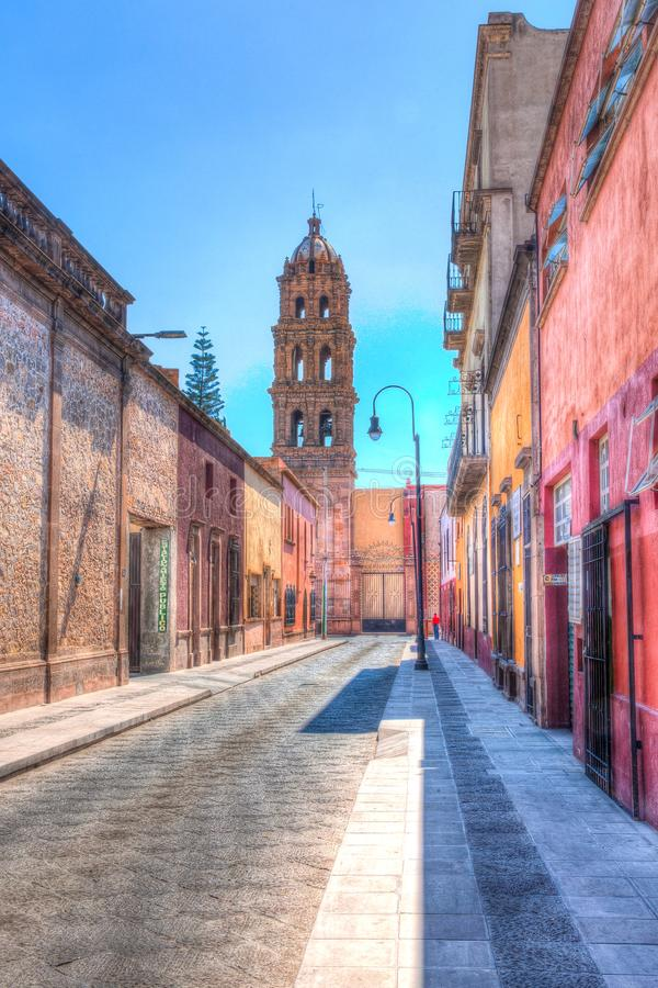 Church Steeple in Old Section of Downtown San Luis Potosi, Mexico. Church steeple with old street lamps in downtown San Luis Potosi, Mexico royalty free stock images