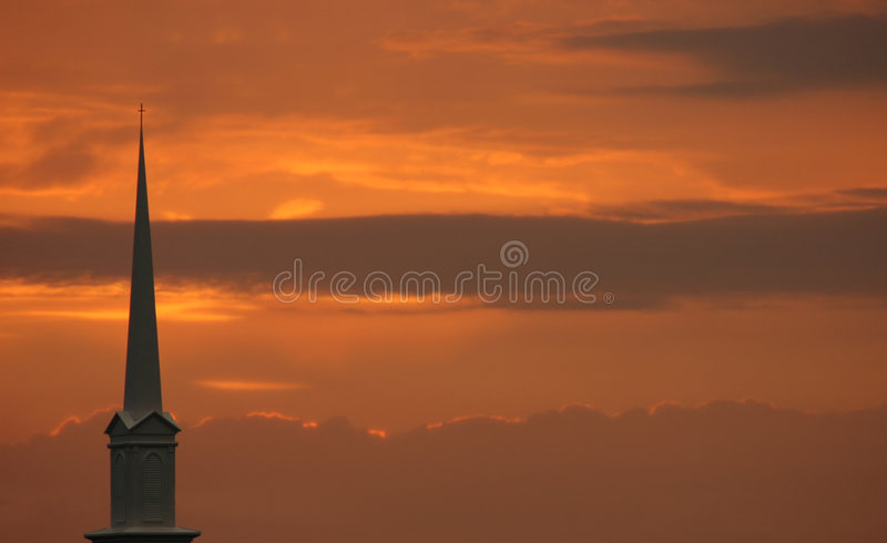 Church Steeple Set Against Sunset Stock Photo