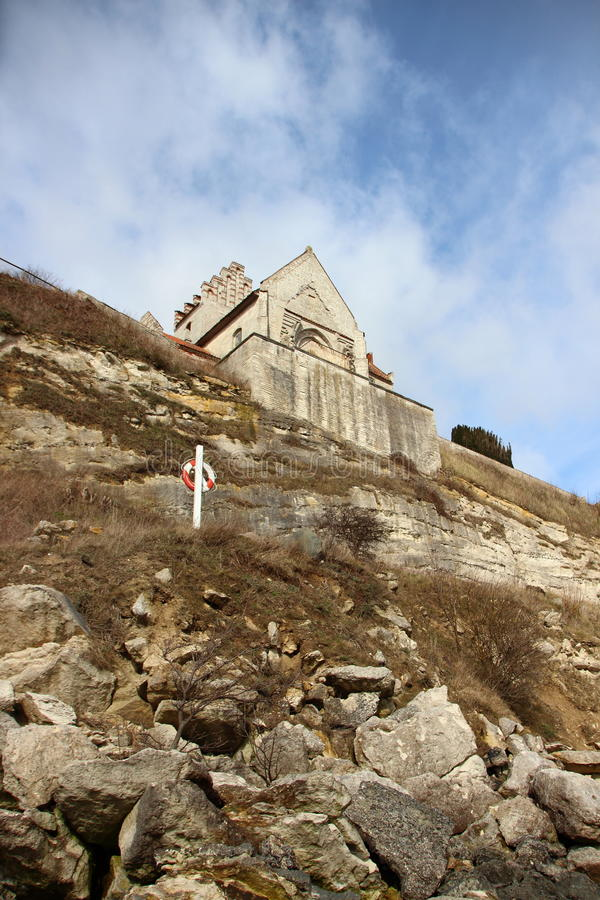 Church at Stevn Klint edge of Cliff with Lifesaver. Ring and White Clouds royalty free stock images