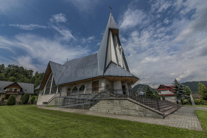 Church in Stromowce Nizne village with blue sky. Church in Stromowce Nizne village in Poland with blue sky after storm royalty free stock photo