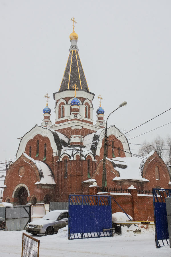Church of the Theotokos of Pochayiv during the snowing. Saltykovka, Moscow region. royalty free stock photos