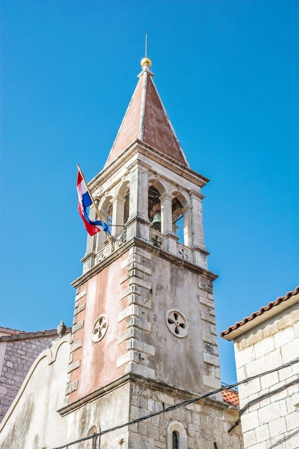 Church tower with Croatian flag, Trogir, Croatia stock photography