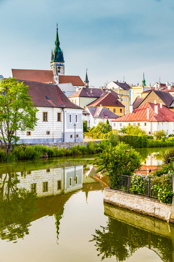 Church Tower-Jindrichuv Hradec,Czech Republic. Beautiful View of Colorful Houses and Church Tower with Reflection on The Water- Jindrichuv Hradec,South Bohemia stock photography