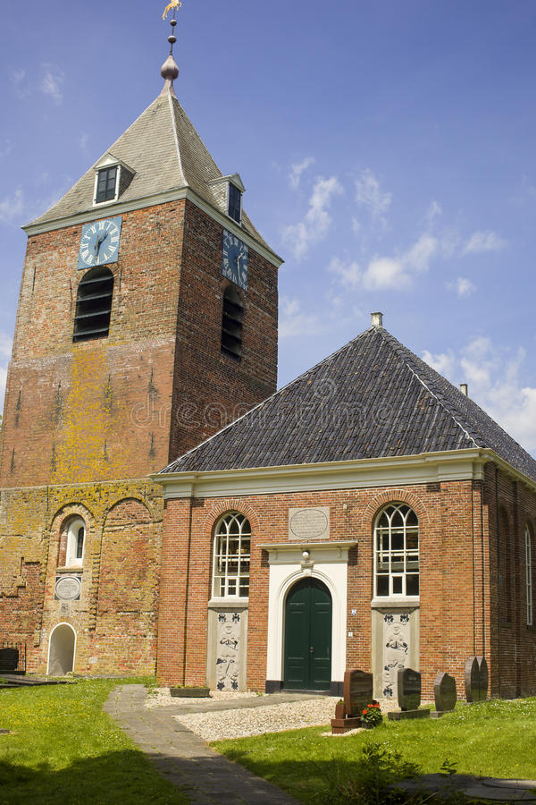 Church and tower in medieval village in the Netherlands. Reformed church in Uitwierde, Groningen in the Netherlands with stand alone tower. The church is new and royalty free stock image