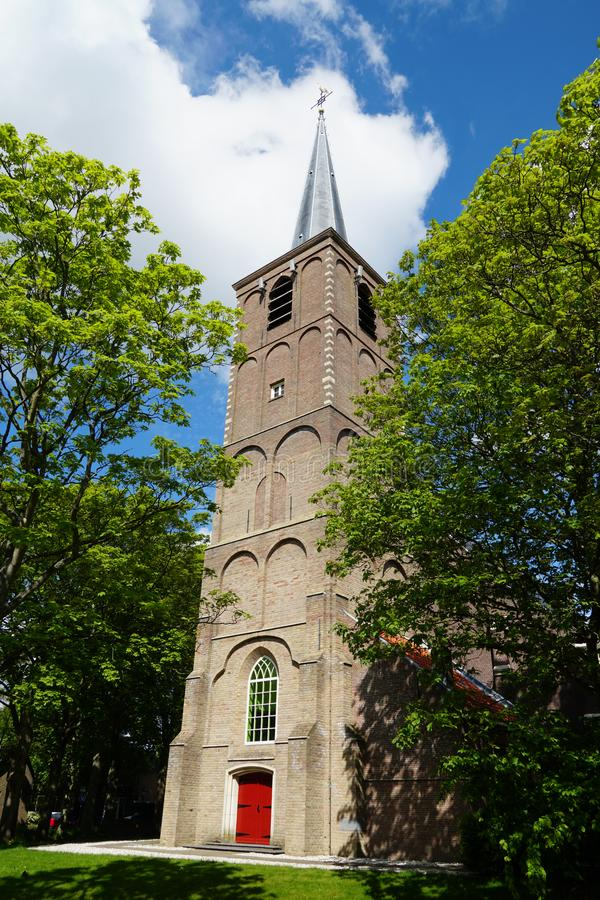 Church tower in Pijnacker in the Netherlands. Old church tower in the village of Pijnacker, Pijnacker-Nootdorp municipality, South Holland province in the stock photos