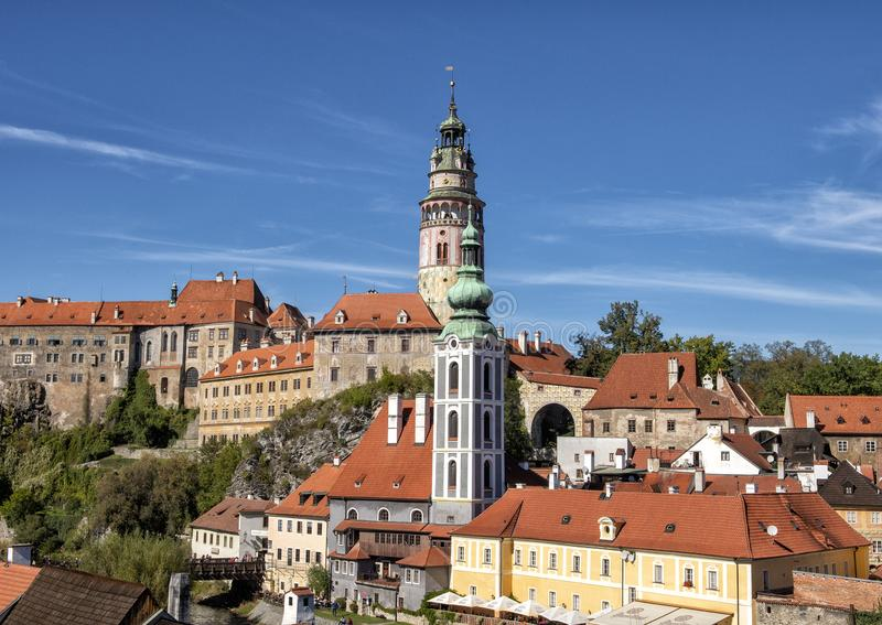 The church tower of the St. Jost Church in Cesky Krumlov, with the Ceskly Castle Tower in the background. royalty free stock image