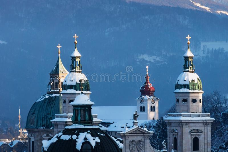 Church towers of the Salzburger Dom in winter, Salzburg, Austria. Church towers of the Salzburger Dom in winter covered with snow, Salzburg, Austria royalty free stock images