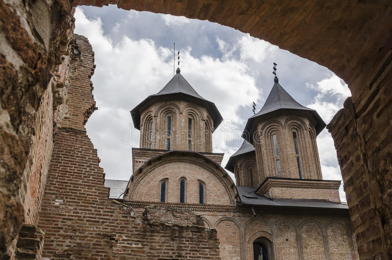 Church towers seen from the Royal Court ruins in Targoviste, Romania. Old Royal Court ruins with the Royal Church of Targoviste, the former Wallachian capital stock photos