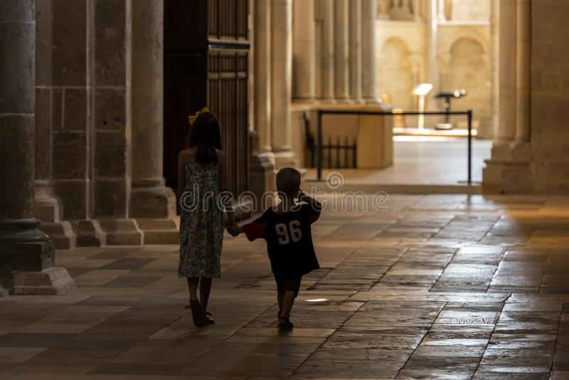 Church Vezelay during Service Children. Vezelay, France - July 29, 2018: Church service with children in the romanesque church and abbey of Vezelay in Yonne stock image