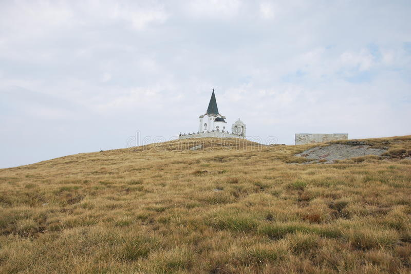 The church which is on the peak of Kajmakchalan, place of a WWI battle. View towards the church, called Prophet Ilia, on Kajmakchalan. This church was built to royalty free stock image