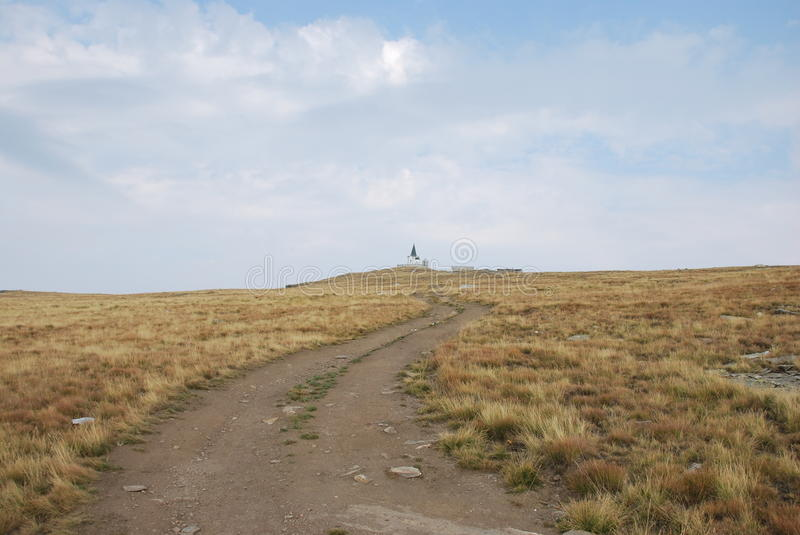 The church which is on the peak of Kajmakchalan, place of a WWI battle. View towards the church, called Prophet Ilia, on Kajmakchalan. This church was built to stock image