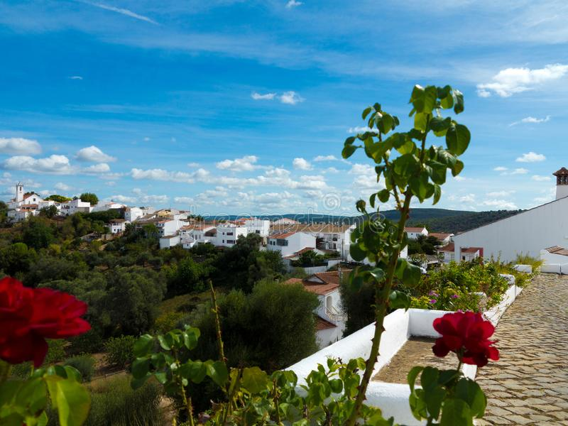 Church and white houses of the beautiful ancient village Salir, Algarve, Portugal stock images