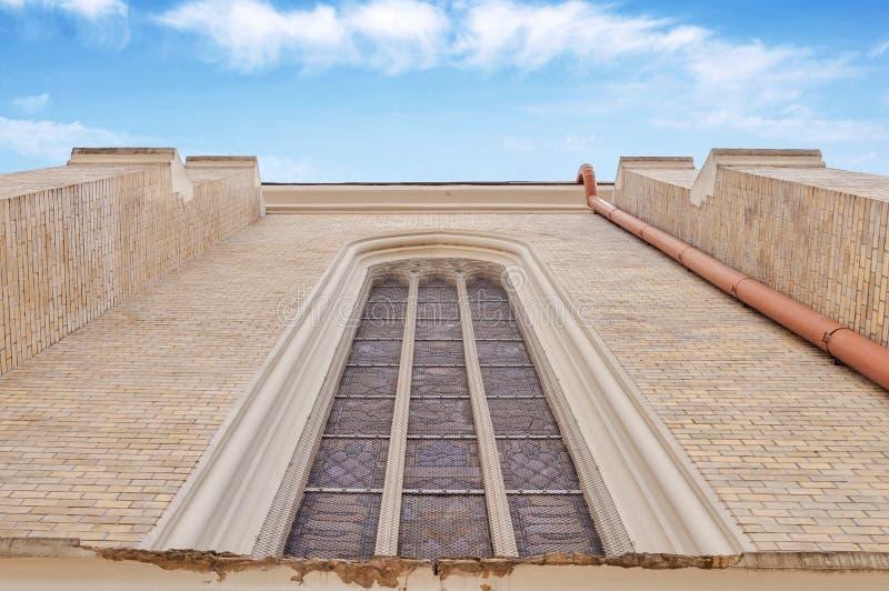 Church window and blue sky stock photos