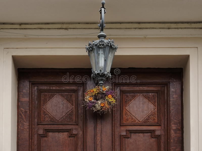 Church wooden door entrance with lamp stock photo